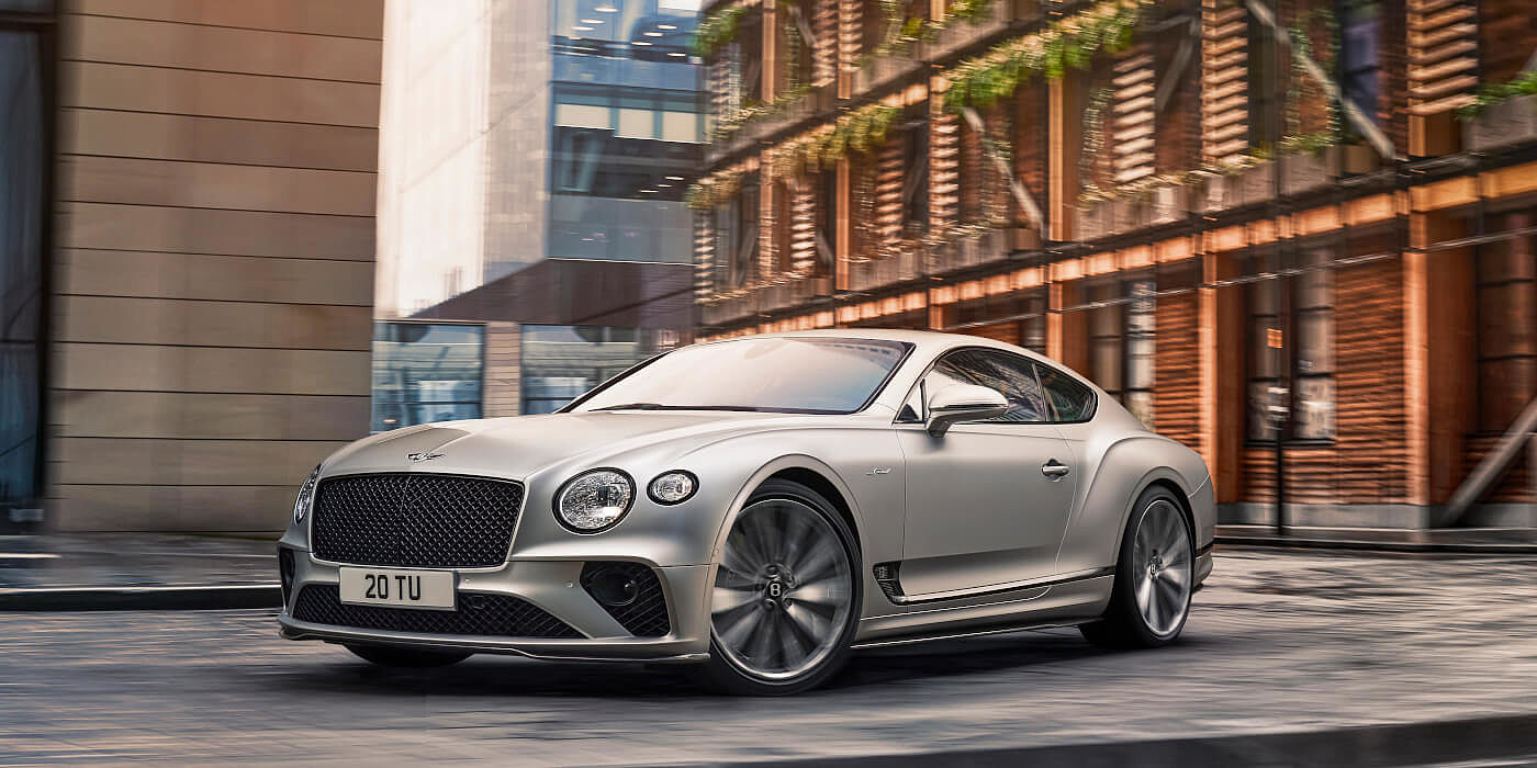 <new-bentley-continental-gt-speed-in-satin-silver-by-mulliner-paint-driving-in-manchester>