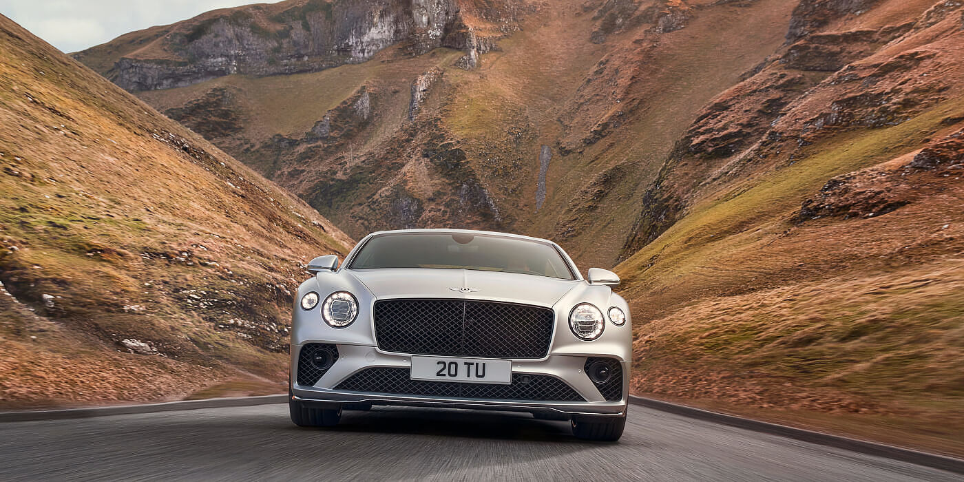 <new-bentley-continental-gt-speed-in-satin-silver-by-mulliner-paint-front-view-peak-district>